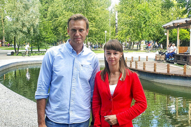 In this August 2020, photo, provided by Alexei Navalny's team, Ksenia Fadeyeva, right, poses for a photo with Alexei Navalny in Tomsk, Russia. Fadeyeva runs the regional headquarters in the Siberian city and is running for the Tomsk city council. Fadeyeva has secured a seat in the city council, according to preliminary results of the regional election that took place on Sunday, Sept. 13, 2020. (Andrei Fateyev/Alexei Navalny's team via AP)