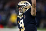 New Orleans Saints quarterback Drew Brees (9) celebrates for a touchdown pass that was called back for offensive pass interference in the first half of an NFL football game against the Indianapolis Colts in New Orleans, Monday, Dec. 16, 2019. The pass, had it counted, would have given Brees the NFL record for career touchdown passes, which he tied Peyton Manning for earlier in the game. (AP Photo/Butch Dill)