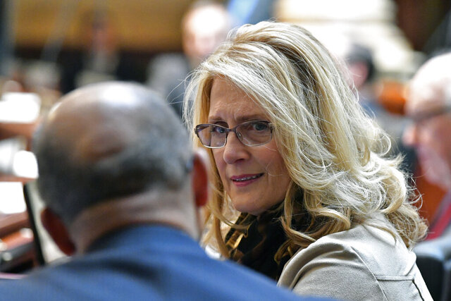 Kentucky Sen. Robin L. Webb, D-Carter, speaks with Sen. Reginald Thomas, D-Fayette, during the opening session of the Kentucky State Legislature in Frankfort, Ky., Tuesday, Jan. 7, 2020. (AP Photo/Timothy D. Easley)
