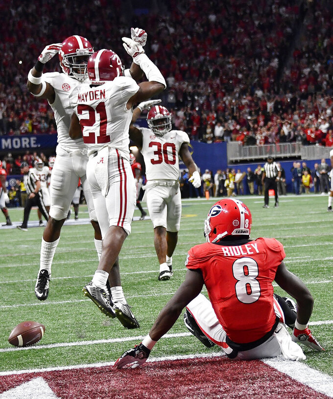 Georgia wide receiver Riley Ridley (8) sits on the turf after missing a pass against Alabama during the second half of the Southeastern Conference championship NCAA college football game, Saturday, Dec. 1, 2018, in Atlanta. Alabama won 35-28. (AP Photo/John Amis)