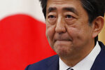 Japan's Prime Minister Shinzo Abe speaks at a news conference in Tokyo Monday, May 25, 2020. Abe lifted a coronavirus state of emergency in Tokyo and four other remaining areas on Monday, ending the restrictions nationwide. (Kim Kyung-hoon/Pool Photo via AP)