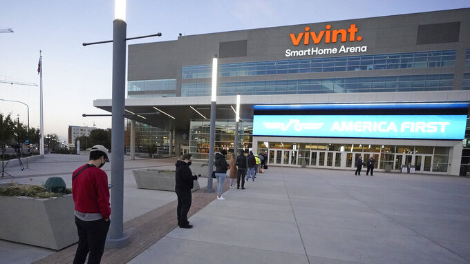 People line up to vote at the Vivint Smart Home Arena Tuesday, Nov. 3, 2020, in Salt Lake City. AP Photo/Rick Bowmer)