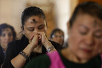 Women listen from their pew during Mass on Ash Wednesday at St. Mary's Cathedral in San Francisco, Wednesday, Feb. 26, 2020. Ash Wednesday for Christians worldwide ushers in a period of penitence and reflection, known as the season of Lent, that leads up to Easter Sunday. (AP Photo/Jeff Chiu)