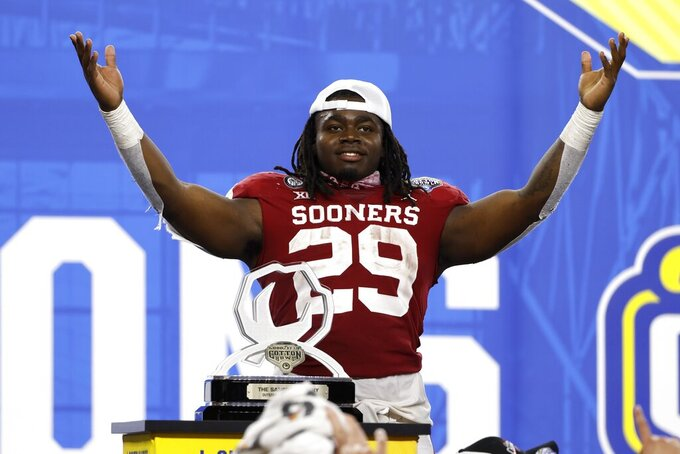 Oklahoma running back Rhamondre Stevenson celebrates after being named outstanding offensive player in the team's 55-20 win over Florida in the Cotton Bowl NCAA college football game in Arlington, Texas, Wednesday, Dec. 30, 2020. (AP Photo/Michael Ainsworth)