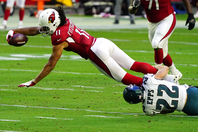 Arizona Cardinals wide receiver Larry Fitzgerald (11) is tackled by Philadelphia Eagles safety Marcus Epps (22) during the first half of an NFL football game, Sunday, Dec. 20, 2020, in Glendale, Ariz. (AP Photo/Rick Scuteri)