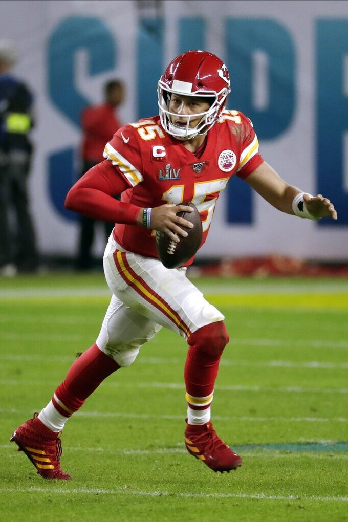 Kansas City Chiefs' quarterback Patrick Mahomes rolls out against the San Francisco 49ers during the second half of the NFL Super Bowl 54 football game Sunday, Feb. 2, 2020, in Miami Gardens, Fla. (AP Photo/Matt York)