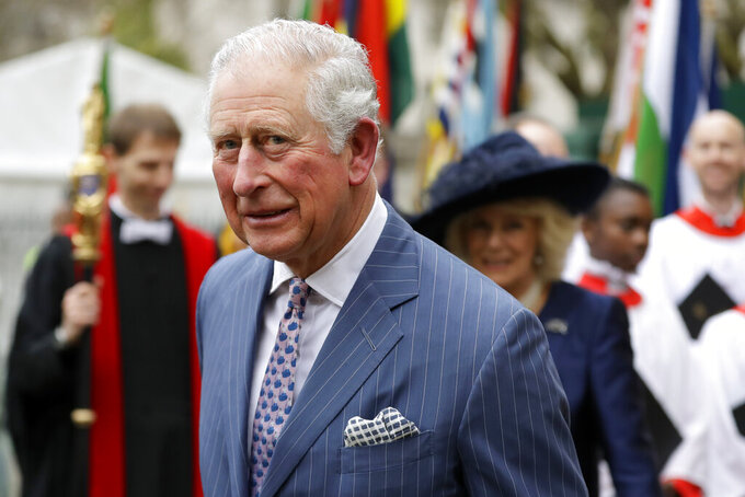 FILE - In this Monday, March 9, 2020 file photo, Britain's Prince Charles and Camilla the Duchess of Cornwall, in the background, leave after attending the annual Commonwealth Day service at Westminster Abbey in London. Prince Charles celebrated his 72nd birthday, on Saturday, Nov. 14, 2020, marking an eventful year that saw him contract the coronavirus and his son Prince Harry step down from official royal duties. Gun salutes would normally be fired from London's Green Park and the Tower of London to mark the heir to the throne's birthday, but officials said the ceremonies won't take place this year due to COVID-19 restrictions. Charles' eldest son Prince William and his wife, Kate, were among those wishing him a happy birthday on social media. (AP Photo/Kirsty Wigglesworth, File)