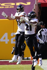 Baltimore Ravens tight end Mark Andrews (89) celebrates his touchdown against the Washington Football Team with Baltimore Ravens running back Mark Ingram (21) during the second half of an NFL football game, Sunday, Oct. 4, 2020, in Landover, Md. (AP Photo/Susan Walsh)