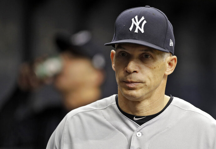 FILE - This May 20, 2017 file photo shows New York Yankees manager Joe Girardi during a baseball game against the Tampa Bay Rays in St. Petersburg, Fla.  Person familiar with deal tells AP the Philadelphia Phillies are hiring Girardi as manager, Thursday, Oct. 24, 2019.   (AP Photo/Chris O'Meara, File)