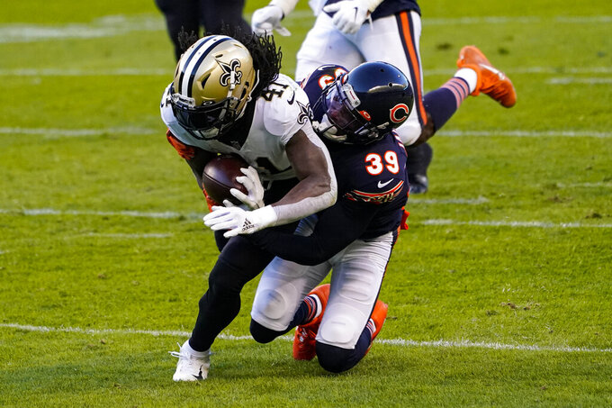 New Orleans Saints running back Alvin Kamara (41) is tackled by Chicago Bears free safety Eddie Jackson (39) after a catch in the first half of an NFL football game in Chicago, Sunday, Nov. 1, 2020. (AP Photo/Charles Rex Arbogast)