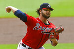 Atlanta Braves' Bryse Wilson pitches against the Boston Red Sox during the first inning of a baseball game Sunday, Sept. 27, 2020, in Atlanta. (AP Photo/John Amis)