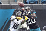 Pittsburgh Steelers wide receiver Diontae Johnson (18) can't make the catch as Jacksonville Jaguars safety Daniel Thomas (20) defends during the first half of an NFL football game, Sunday, Nov. 22, 2020, in Jacksonville, Fla. (AP Photo/Phelan M. Ebenhack)