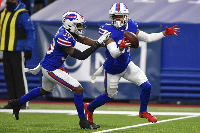 Buffalo Bills strong safety Dean Marlowe, right, celebrates with teammate Levi Wallace (39) after recovering a fumble by New England Patriots quarterback Cam Newton (1) during the second half of an NFL football game Sunday, Nov. 1, 2020, in Orchard Park, N.Y. The Bills won 24-21. (AP Photo/Adrian Kraus)