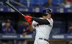 Boston Red Sox's Rafael Devers lines an RBI-single off Tampa Bay Rays relief pitcher Austin Pruitt during the fourth inning of a baseball game Monday, Sept. 23, 2019, in St. Petersburg, Fla. Boston's Marco Hernandez scored. (AP Photo/Chris O'Meara)