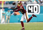 Washington Redskins wide receiver Terry McLaurin (17) grabs a pass, during the second half at an NFL football game against the Miami Dolphins, Sunday, Oct. 13, 2019, in Miami Gardens, Fla. McLaurin scored two touchdowns. The Redkskins defeated the Dolphins 17-16. (AP Photo/Brynn Anderson)