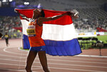 Sifan Hassan of the Netherlands celebrates after winning the gold in the women's 10,000m final at the World Athletics Championships in Doha, Qatar, Saturday, Sept. 28, 2019. (AP Photo/Nariman El-Mofty)