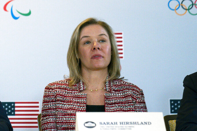 "FILE - In this Feb. 18, 2020, file photo, United States Olympic and Paralympic Committee CEO Sarah Hirshland listens during a briefing with the U.S. Olympic and Paralympic Committee and Los Angeles 2028 organizers in Beverly Hills, Calif. A boycott of next year's Beijing Olympics will not solve any geopolitical issues with China and will only serve to place athletes training for the games under a ""cloud of uncertainty,"" according to a letter, Hirshland, the head of the U.S. Olympic and Paralympic Committee, wrote to Congress on Thursday, May 13, 2021. Her letter specifically addressed those who believe a boycott of the Winter Games next February would serve as an effective diplomatic tool to protest China's alleged abuses toward Uyghurs, Tibetans and Hong Kong residents.  (AP Photo/Evan Vucci, File)"
