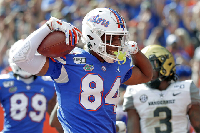 Florida tight end Kyle Pitts (84) celebrates after scoring a touchdown on a 15-yard pass reception during the second half of an NCAA college football game against Vanderbilt, Saturday, Nov. 9, 2019, in Gainesville, Fla. (AP Photo/John Raoux)