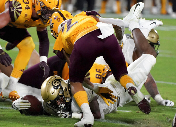 Colorado tailback Alex Fontenot (8) dives across the goal line scoring their first touchdown against Arizona State defense during the second half of an NCAA college football game Saturday, Sept 25, 2021, in Tempe, Ariz. (AP Photo/Darryl Webb)