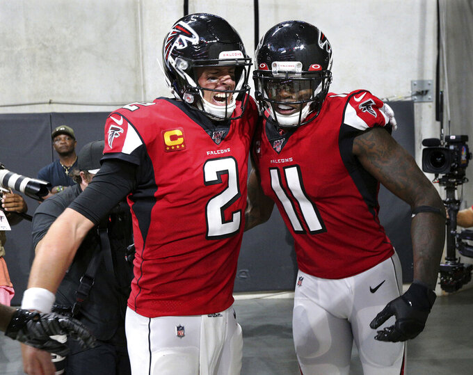 Atlanta Falcons quarterback Matt Ryan (2) celebrates with wide receiver Julio Jones (11) who ran down the tunnel after his go-ahead and eventual game-winning touchdown reception against the Philadelphia Eagles in an NFL football game, Sunday, Sept. 15, 2019, in Atlanta. Atlanta won 24-20. (Curtis Compton/Atlanta Journal-Constitution via AP)