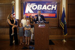 Flanked by family members, former Kansas Secretary of State Kris Kobach announces his candidacy for the Republican nomination for the U.S. Senate Monday, July 8, 2019, in Leavenworth, Kan. (AP Photo/Charlie Riedel)