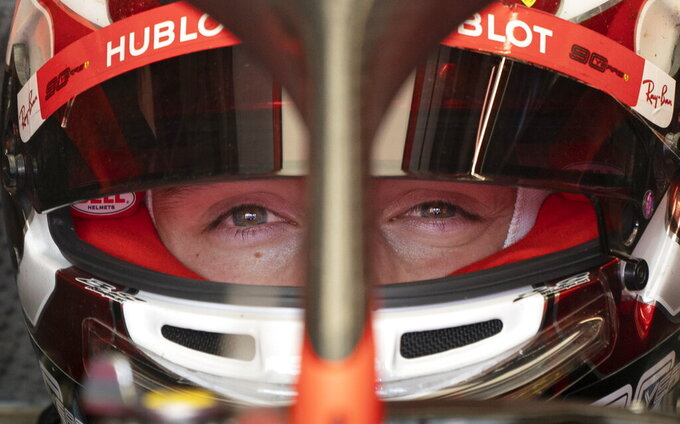 Ferrari driver Charles Leclerc of Monaco sits in his car during the second practice session at the Formula One Canadian Grand Prix auto race, Friday, June 7, 2019, in Montreal. (Paul Chiasson/The Canadian Press via AP)