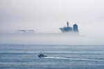 A view of the Grace 1 supertanker is seen through the sea fog, in the British territory of Gibraltar, Thursday, Aug. 15, 2019, seized last month in a British Royal Navy operation off Gibraltar.  The United States moved on Thursday to halt the release of the Iranian supertanker Grace 1, detained in Gibraltar for breaching EU sanctions on oil shipments to Syria, thwarting efforts by authorities in London and the British overseas territory to defuse tensions with Tehran. (AP Photo/Marcos Moreno)