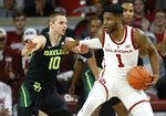 Oklahoma guard Rashard Odomes (1) drives against Baylor guard Makai Mason (10) in the first half of an NCAA college basketball game in Norman, Okla., Monday, Jan. 28, 2019. (AP Photo/Sue Ogrocki)