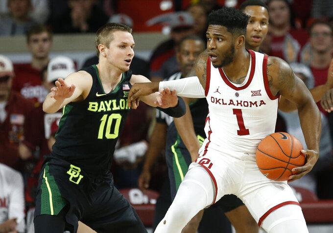 Oklahoma guard Rashard Odomes (1) drives against Baylor guard Makai Mason (10) in the first half of an NCAA college basketball game in Norman, Okla., Monday, Jan. 28, 2019. (AP Photo/Sue Ogrocki)