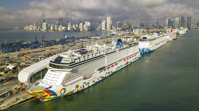 The Norwegian Encore cruise ship is docked at the Port of Miami on Thursday, March 26, 2020, in Miami, Fla. (Al Diaz/Miami Herald via AP)