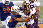 Minnesota running back Mohamed Ibrahim (24) carries the ball as Illinois defensive back Sydney Brown defends during the second half of an NCAA college football game Saturday, Nov. 7, 2020, in Champaign, Ill. Minnesota won 41-14. (AP Photo/Charles Rex Arbogast)