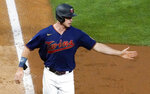 Minnesota Twins' Max Kepler reaches for a congratulatory hand as he scores the go-ahead run off on a wild pitch from Detroit Tigers' Jose Cisnero in the seventh inning of a baseball game, Thursday, July 8, 2021, in Minneapolis. (AP Photo/Jim Mone)