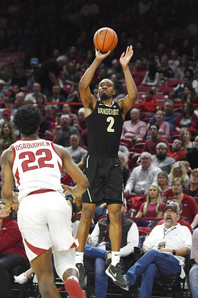 Vanderbilt guard Joe Toye (2) shoots a three-point shot over Arkansas defender Gabe Osabuohien (22) during the first half of an NCAA college basketball game, Tuesday, Feb. 5, 2019 in Fayetteville, Ark. (AP Photo/Michael Woods)