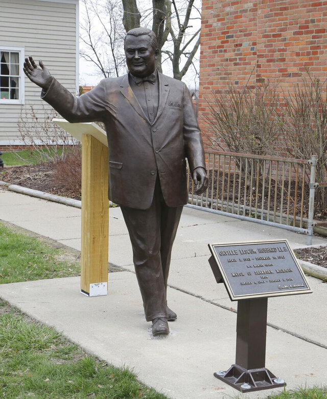 FILE - In this April 27, 2018, a statue of former Mayor Orville Hubbard, is displayed in Dearborn, Mich. Elected officials in the Detroit suburb are wiping away part of the community's segregationist past by removing the name of its longest-serving mayor from a civic center ballroom. The action Tuesday, Jan. 26, 2021, by the Dearborn City Council is the latest move to separate the city from Orville Hubbard's political legacy which included efforts to keep Black families from moving into the then-mostly white community. (AP Photo/Carlos Osorio, File)