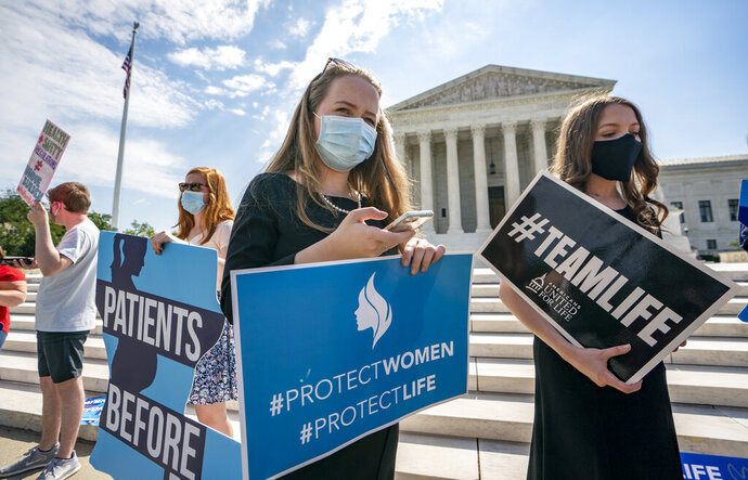 Anti-abortion activists wait in vain outside the Supreme Court for a decision, Thursday, June 25, 2020 in Washington. There was no announcement on the Louisiana case, Russo v. June Medical Services LLC. (AP Photo/J. Scott Applewhite)