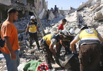 This photo provided by the Syrian Civil Defense White Helmets, which has been authenticated based on its contents and other AP reporting, shows Syrian White Helmet civil defense workers search for victims from under the rubble of a destroyed building that hit by Syrian government and Russian airstrikes, in the northern town of Maaret al-Numan, in Idlib province, Syria, Monday, July 22, 2019. Syrian opposition activists say an airstrike on a busy market in a rebel-held town in northwestern Syria has killed at least 16 people. (Syrian Civil Defense White Helmets via AP)