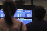 People look at an electronic stock board showing reopened Japan's Nikkei 225 index at Tokyo Stock Exchange in Tokyo Friday, Oct. 2, 2020. Tokyo's market resumed trading Friday after a full-day outage due to a malfunction in its computer systems. (AP Photo/Eugene Hoshiko)