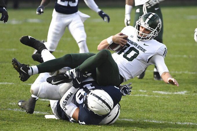 Michigan State quarterback Payton Thorne (10) is sacked by Penn State defensive end Shaka Toney (18) in the first quarter of an NCAA college football game in State College, Pa., on Saturday, Dec. 12, 2020. (AP Photo/Barry Reeger)