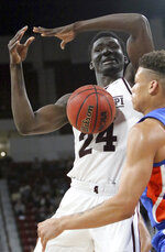 Florida forward Keyontae Johnson, right, strips the ball from Mississippi State forward Abdul Ado (24) during the second half of an NCAA college basketball game Tuesday, Jan. 15, 2019, in Starkville, Miss. Mississippi State won 71-68. (AP Photo/Jim Lytle)