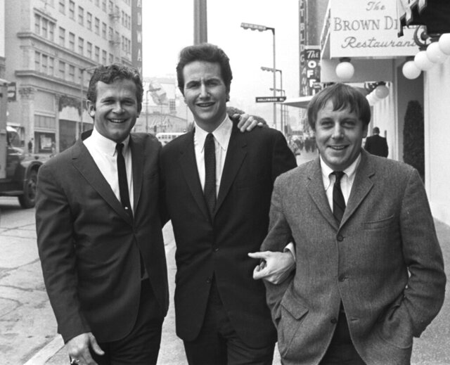 """FILE - In this Jan. 31, 1967, file photo, members of the Kingston Trio, from left: Bob Shane, John Stewart and Nick Reynolds are pictured in the Hollywood section of Los Angeles. Shane, the last surviving original member of the popular folk group the Kingston Trio and the lead singer on its million-selling ballad """"Tom Dooley"""" and many other hits, died Sunday, Jan. 26, 2020, in Phoenix. He was 85. (AP Photo/File)"""