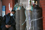 A COVID-19 patient receives oxygen outside an emergency ward at a government-run hospital in Kathmandu, Nepal, Thursday, May 13, 2021. (AP Photo/Niranjan Shrestha)