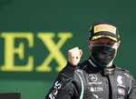 Race winner Mercedes driver Valtteri Bottas of Finland celebrates after winning the Austrian Formula One Grand Prix at the Red Bull Ring racetrack in Spielberg, Austria, Sunday, July 5, 2020. (Mark Thompson/Pool via AP)