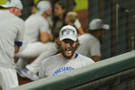 Los Angeles Dodgers starting pitcher Clayton Kershaw celebrates near the family area after winning Game 7 of a baseball National League Championship Series against the Atlanta Braves Sunday, Oct. 18, 2020, in Arlington, Texas. (AP Photo/Eric Gay)