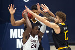 Saint Mary's forward Malik Fitts (24) is double-teamed by Winthrop guard Micheal Anumba (3) and guard Hunter Hale (13) during the second half of an NCAA college basketball game, Monday, Nov. 11, 2019 in Moraga, Calif. Winthrop upset 18th-ranked Saint Mary's 61-59. (AP Photo/D. Ross Cameron)