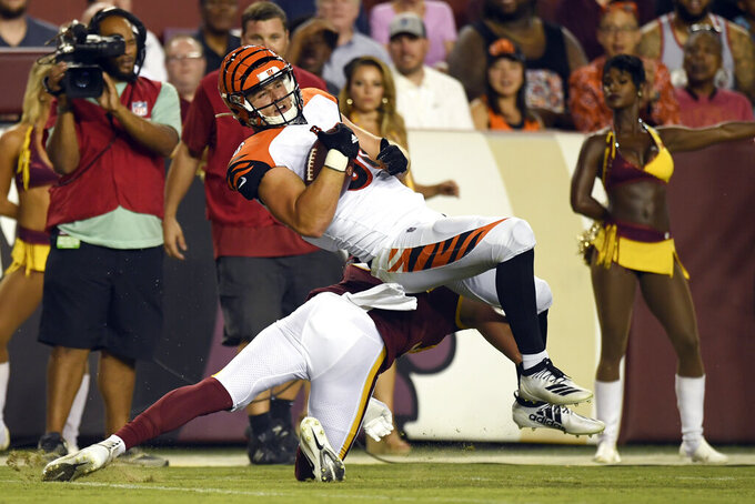 Cincinnati Bengals tight end Mason Schreck, top, rolls over Washington Redskins safety Troy Apke during the second quarter of an NFL preseason football game in Landover, Md., Thursday, Aug. 15, 2019. (AP Photo/Susan Walsh)