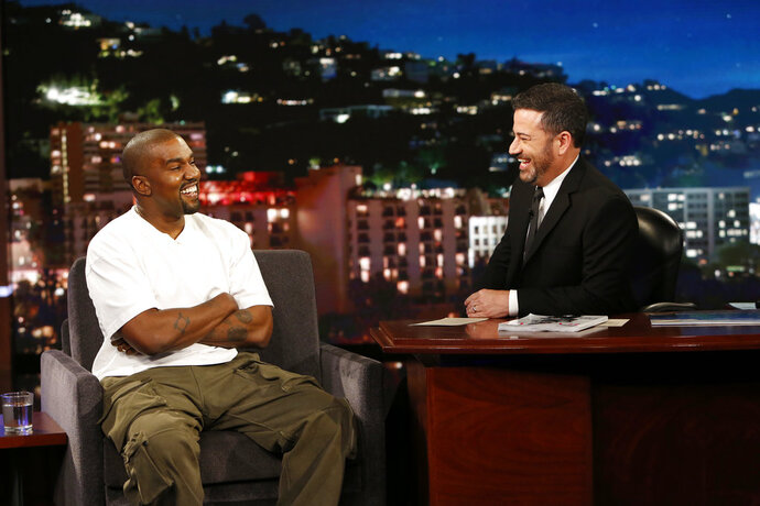In this image released by ABC, musician Kanye west, left, and host Jimmy Kimmel appear on the set of