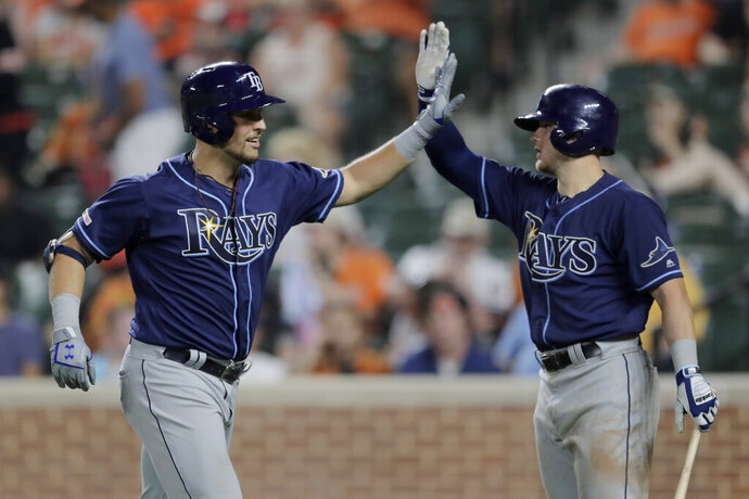 Tampa Bay Rays' Nate Lowe, left, is greeted near the dugout by Michael Brosseau after hitting a two-run home run off Baltimore Orioles relief pitcher Tayler Scott during the ninth inning of the second baseball game of a doubleheader Saturday, July 13, 2019, in Baltimore. The Rays won 12-4. (AP Photo/Julio Cortez)