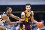Minnesota guard Payton Willis, right, brings the ball up court in front of Butler guard Kamar Baldwin in the second half of an NCAA college basketball game in Indianapolis, Tuesday, Nov. 12, 2019. Butler won 64-56. (AP Photo/AJ Mast)