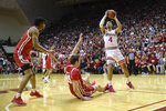 Indiana forward Trayce Jackson-Davis (4) shoots after charging Wisconsin forward Nate Reuvers (35) in the first half of an NCAA college basketball game in Bloomington, Ind., Saturday, March 7, 2020. Wisconsin won 60-56. (AP Photo/AJ Mast)