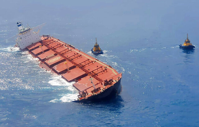 This Feb. 27, 2020 photo released by the Brazilian Navy shows cargo ship Stellar Banner partially emerged offshore of Sao Luis in Maranhao state, Brazil. The cargo ship grounded off the coast of Brazil has begun leaking oil, the country's environmental enforcement agency said Friday. (Brazilian Navy via AP)
